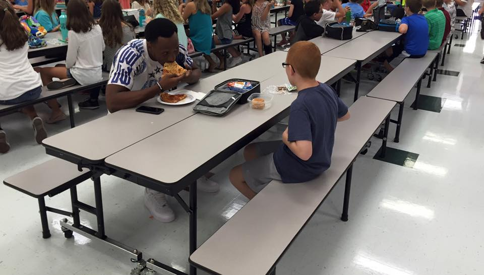 Florida State receiver Travis Rudolph eats lunch with autistic boy sitting by himself